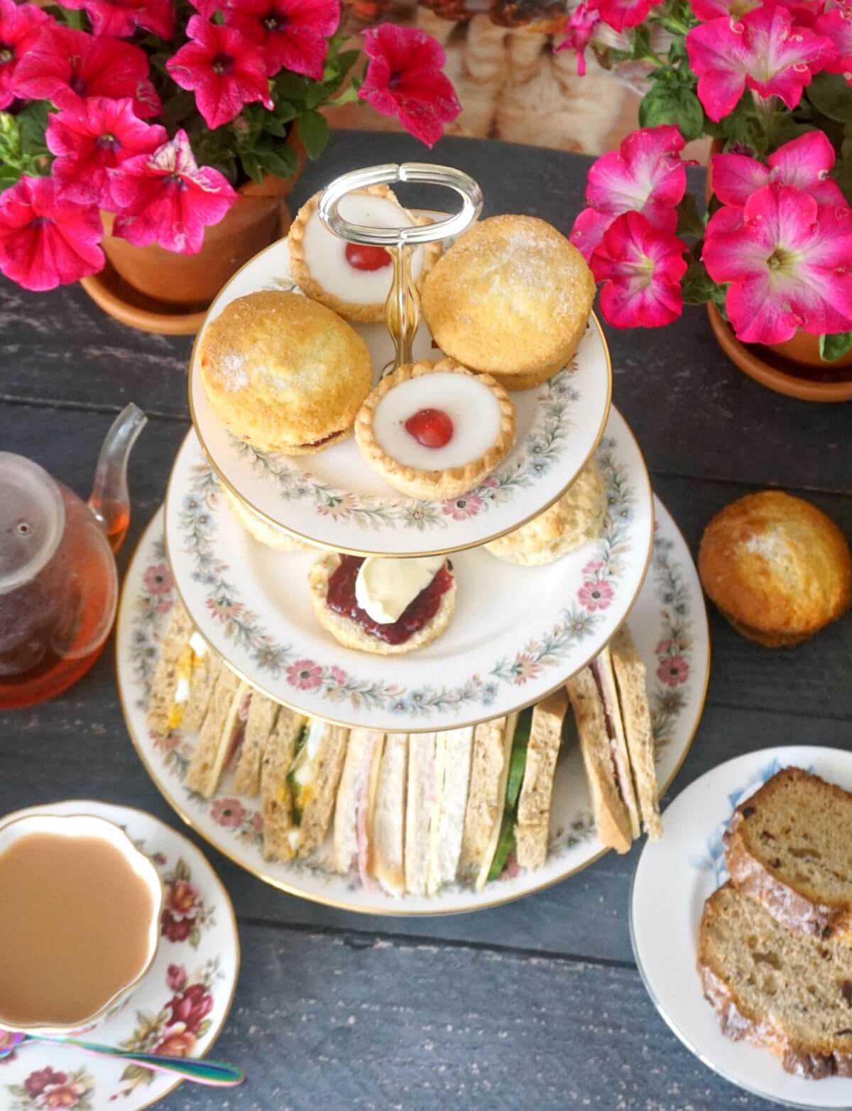 A cake stand with afternoon tea treats