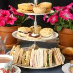 A 3-tiered cake stand with afternoon tea treats