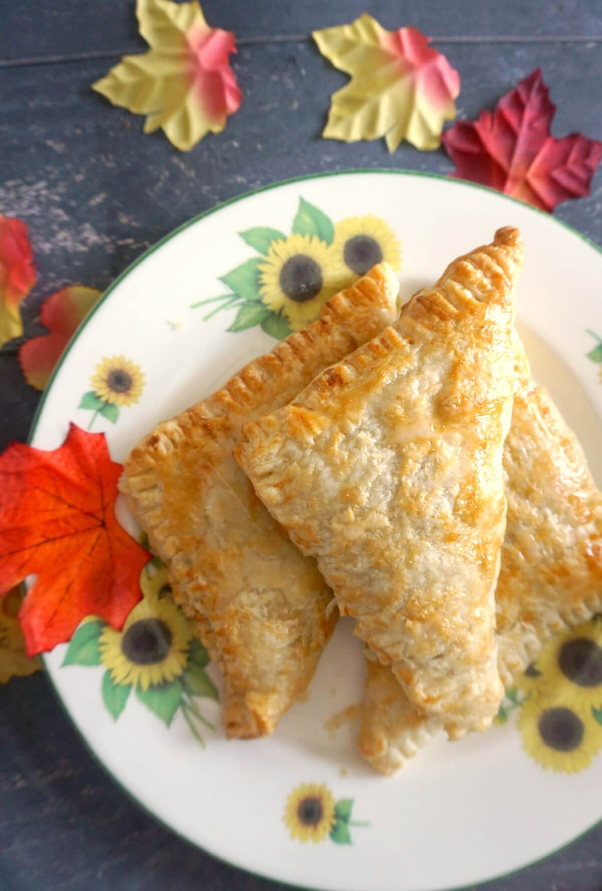2 apple turnovers on a large plate