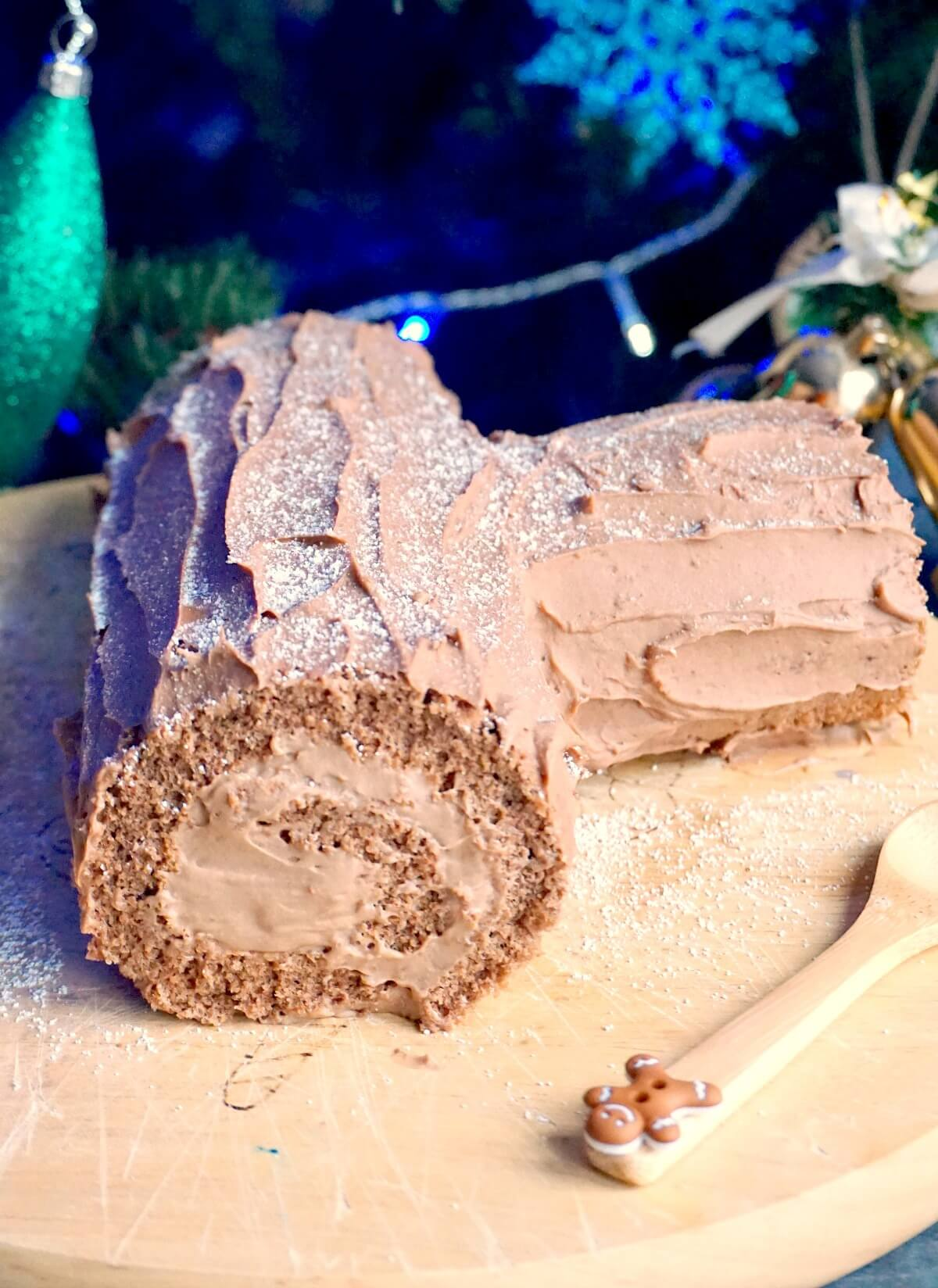 A chocolate yule log on a wooden board
