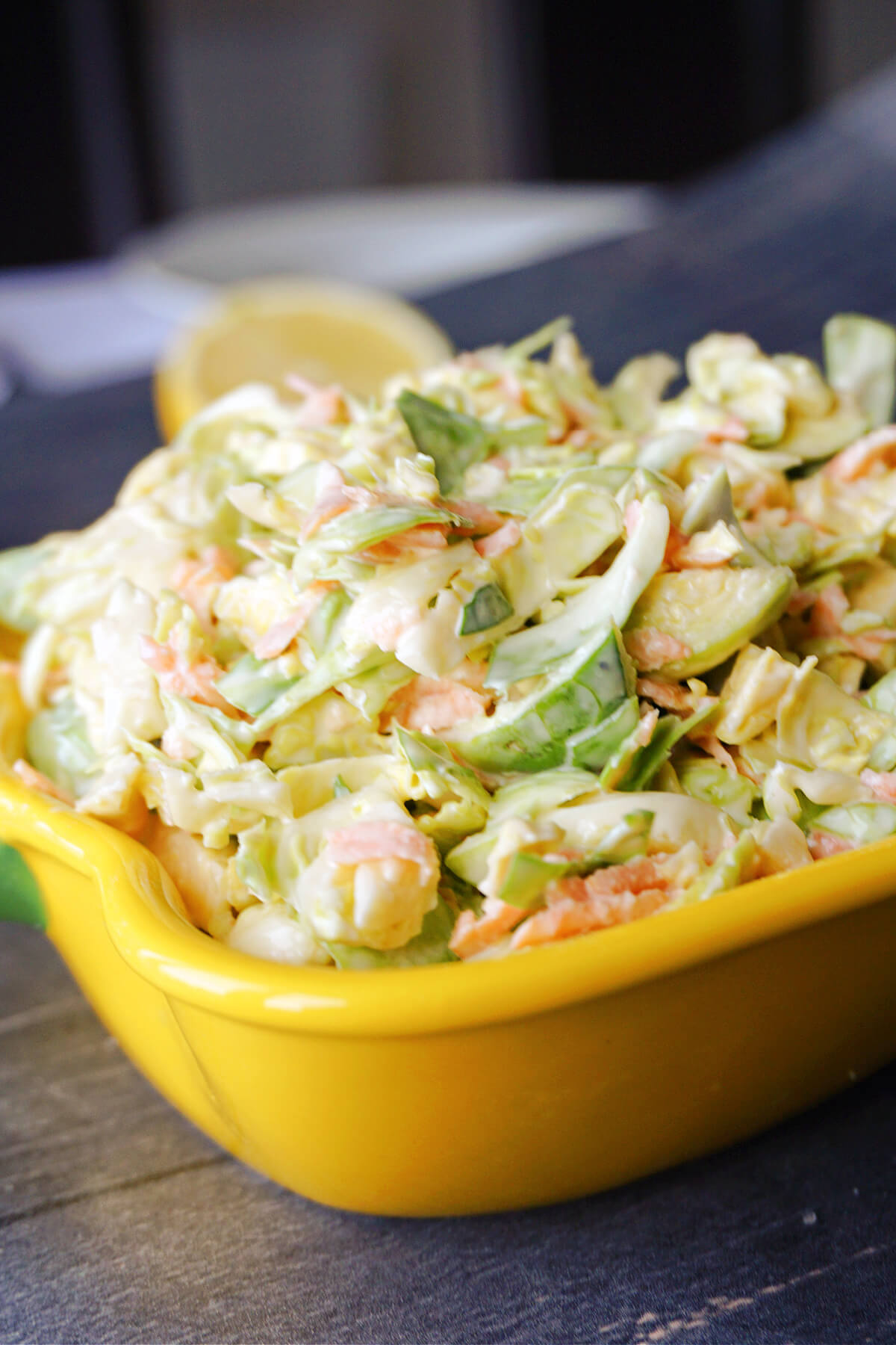 Close-up shoot of a yellow dish with brussel sprout slaw