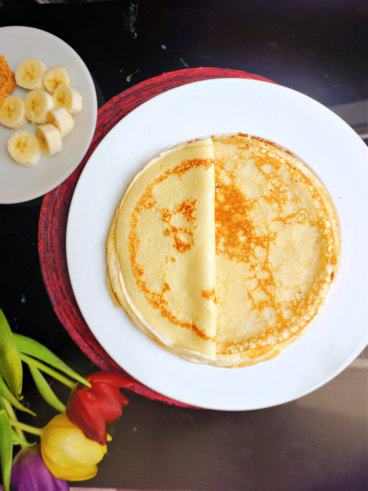 Overhead shot of a white plate with crepes