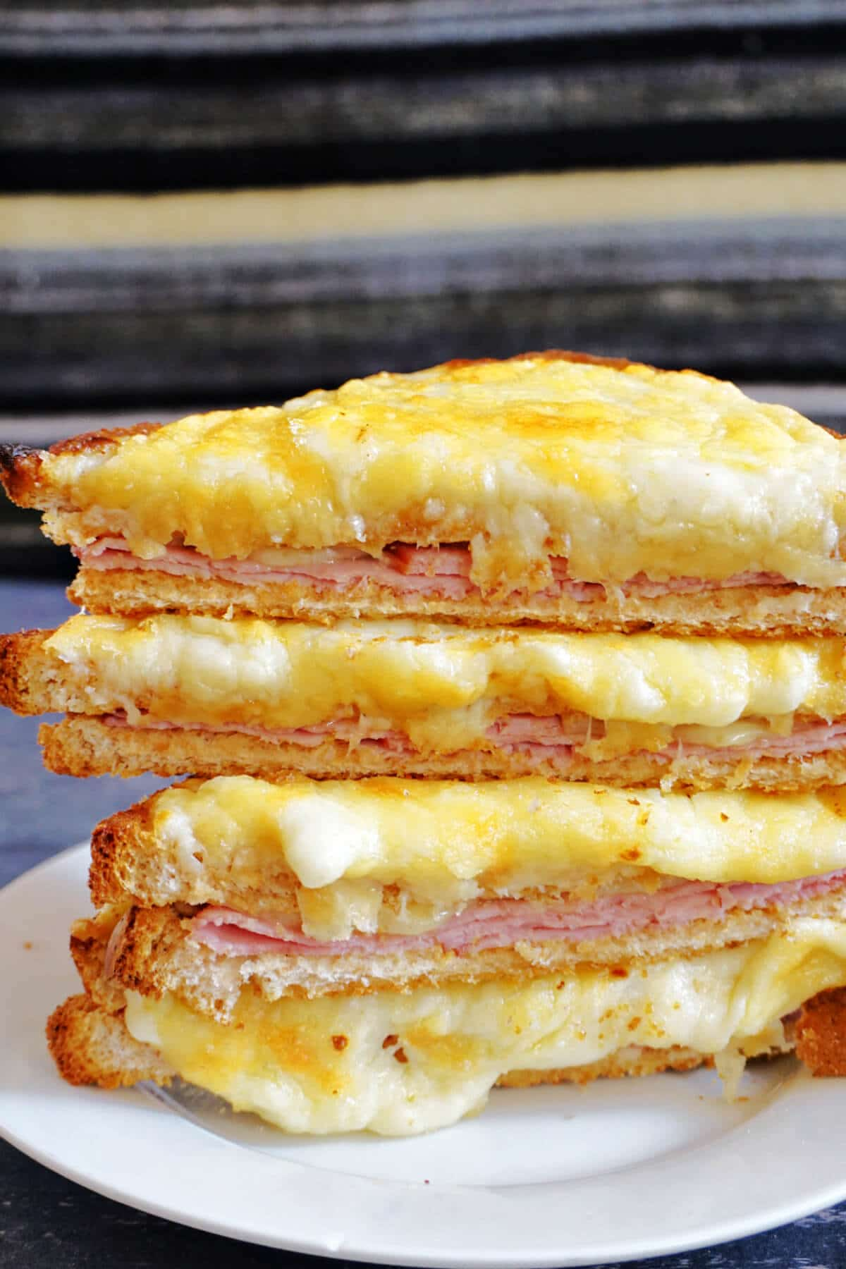 A stack of croque monsieur on a white plate
