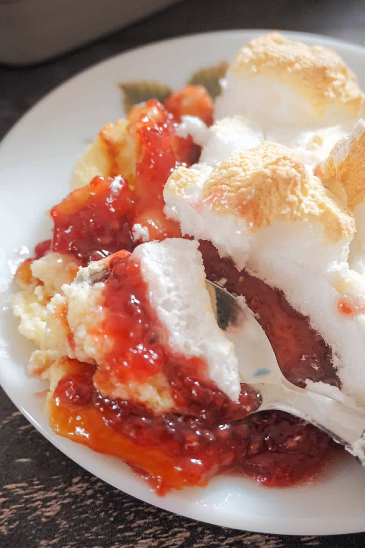 Close-up shot of a white plate with queen of puddings