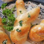 A plate with a bunny-shaped garlic knot