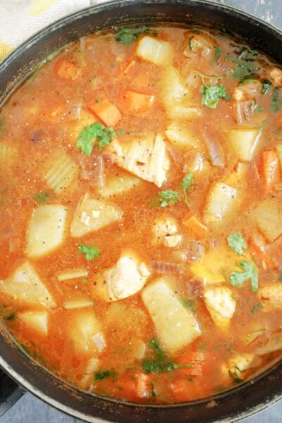 Overhead shot of a pan with chicken and potato stew