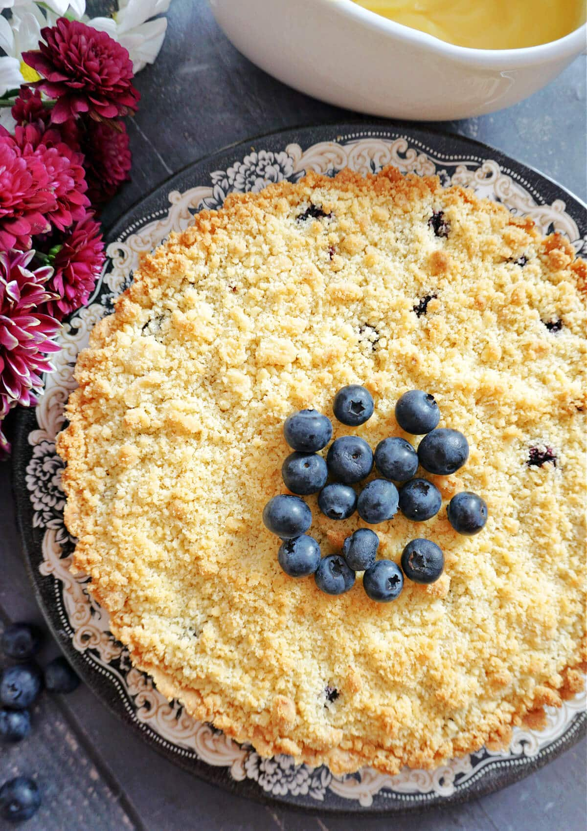 Overhead shot of a blueberry pie topped with blueberries