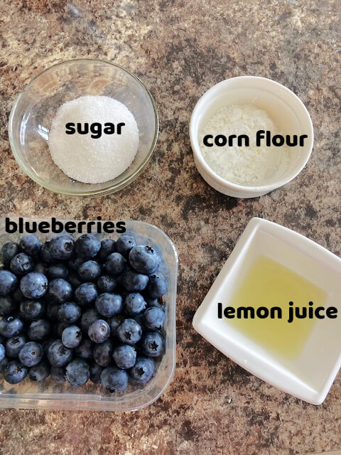 Overhead shot of 4 ingredients for the blueberry pie filling