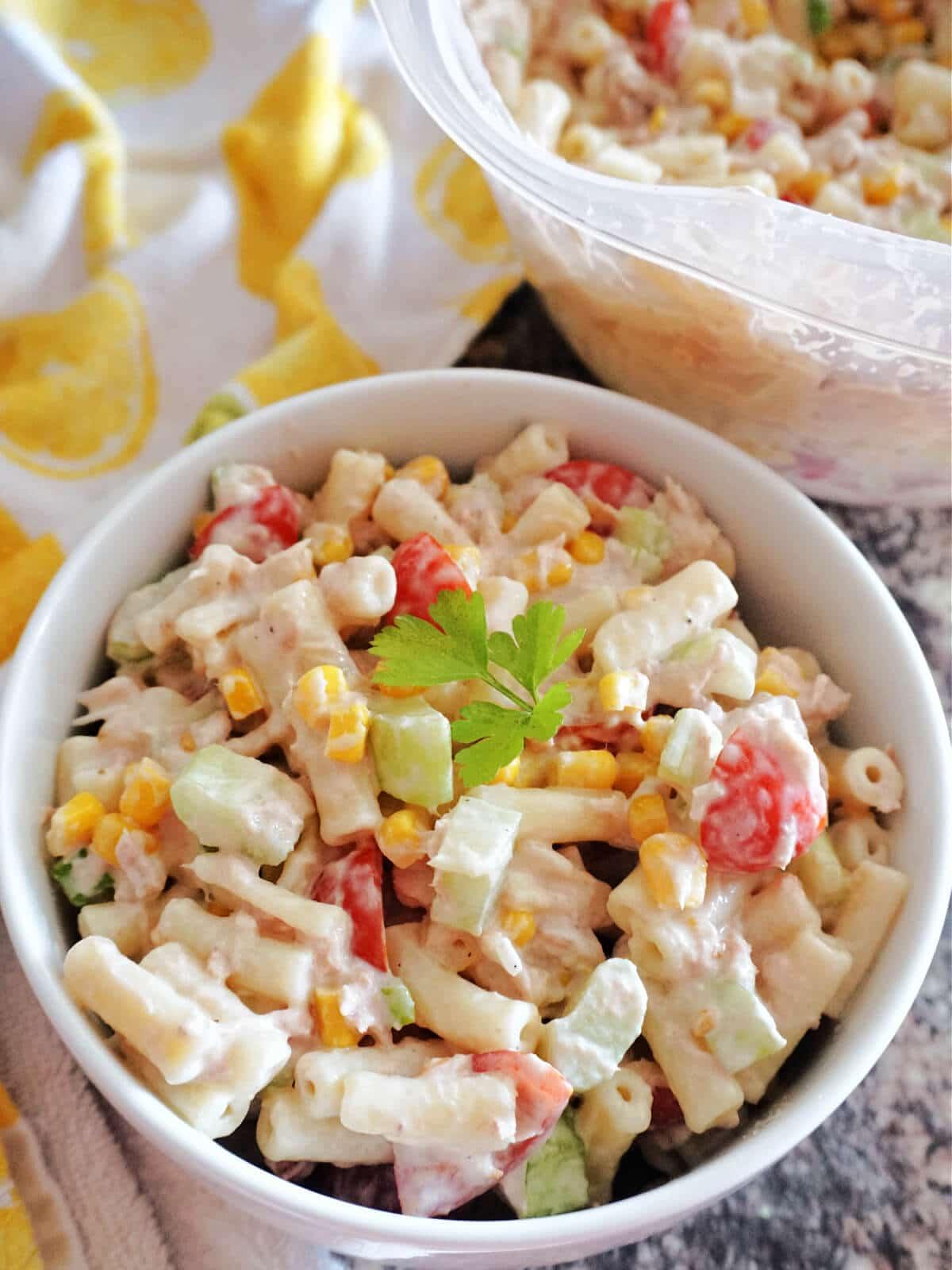 A white bowl of tuna pasta with veggies