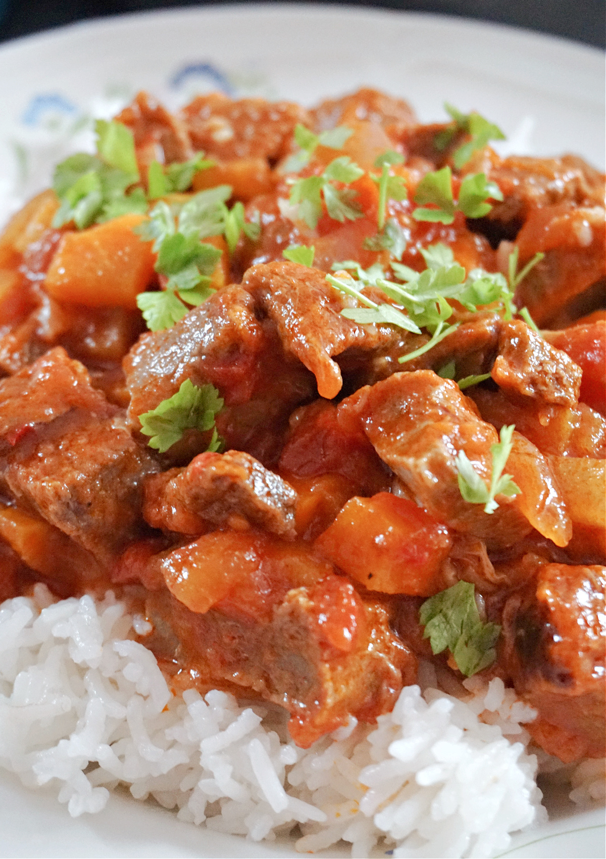Close-up shot of beef chilli over a bed of rice