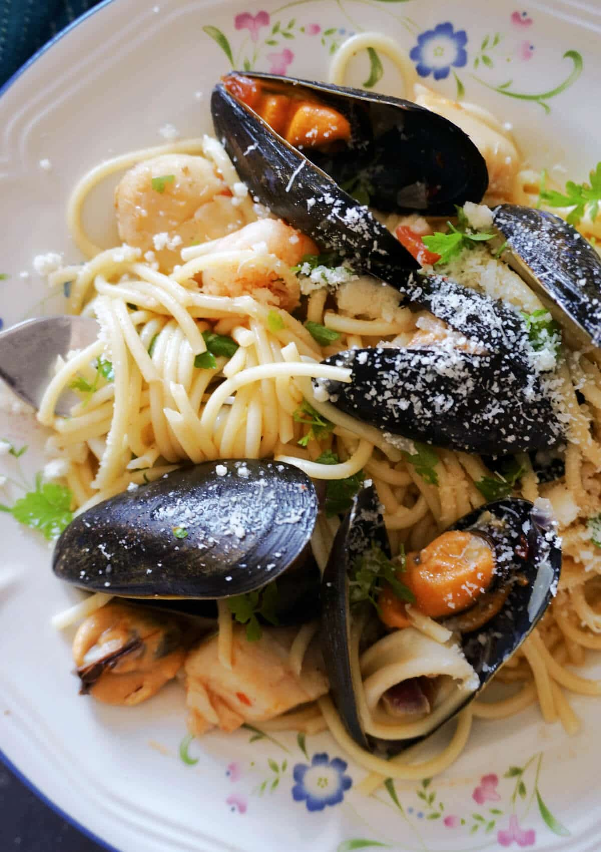 Close-up shot of a plate with spaghetti and seafood