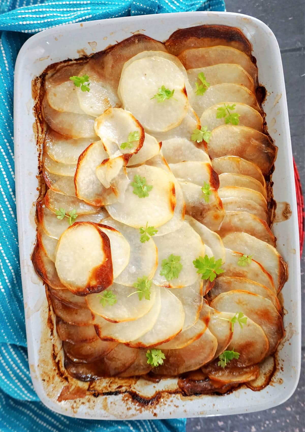 Overhead shot of a dish with  hotpot topped with sliced potatoes