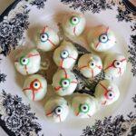 Overhead shoot of a plate with 12 eyeball truffles