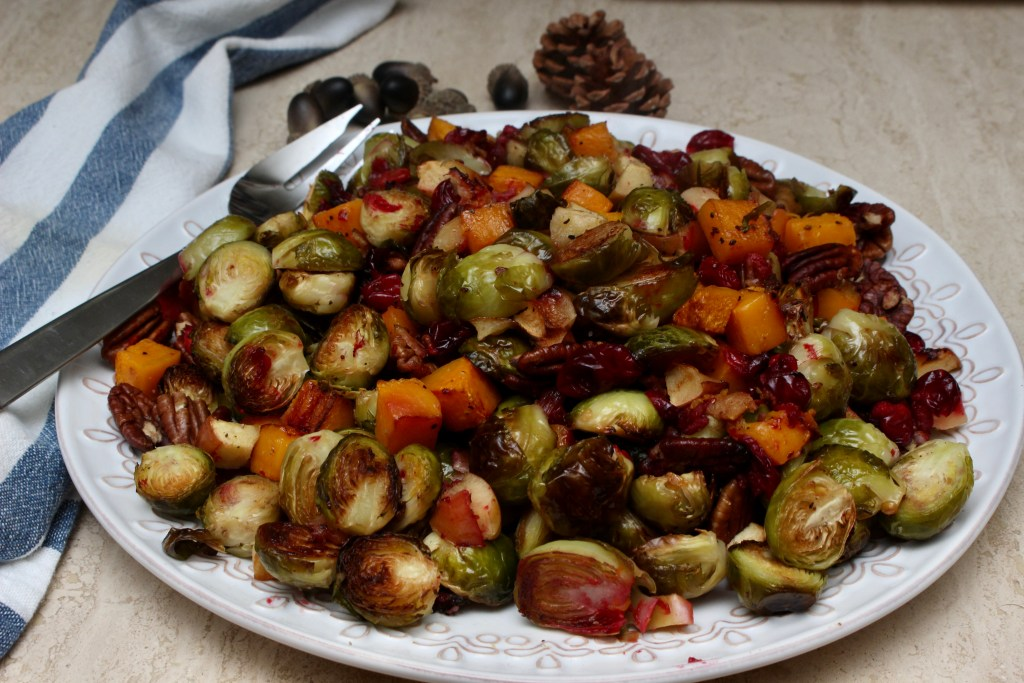 This oven roasted Brussel sprouts with butternut squash side dish is loaded with all of the wonderful fall flavors. Fresh cranberries, apples, pecans and bacon. It makes a great side for a fall weekend dinner or a great addition to your Thanksgiving table.