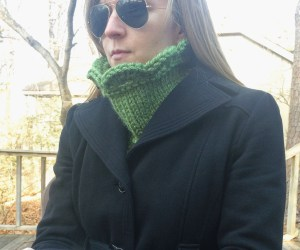 Green Arcade Scallop Cowl on model with cowl flipped up under a coat