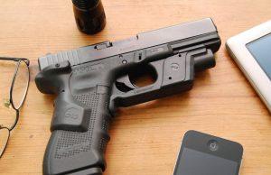 Glock 17, Crimson Trace Lasergrips and Crimson Trace Lightguard