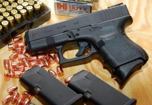 Glock 26 Generation 4 9mm pistol with magazines