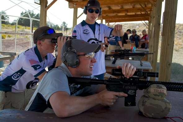 Colt Competition shooters providing some spotting assistance. Wyatt Gibson, with the binocs, toop top Junior honors.