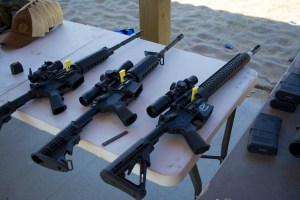 The Media Day range at the Crimson Trace Midnight 3 Gun Invitational displayed especially good manners. Note all guns pointed down range, tabled, with chambers open and chamber flags in place.