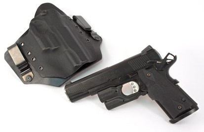 My daily carry setup: Springfield Armory TRP with Crimson Trace Lightguard and Crimson Trace green Lasergrips. Shown with a White Dog IWB holster.