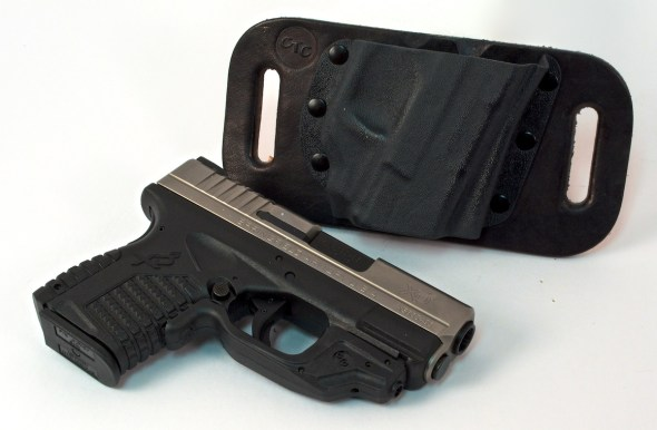 The CrossBreed SnapSlide shown here with a .45 ACP Springfield Armory XD-S with a Crimson Trace LG-469 Laserguard and CrossBreed SnapSlide holster.