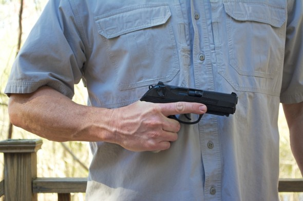 This Beretta PX4 .40 S&W has a strong recoil spring, so proper racking technique is important. First, Keep the gun close to your body to gain leverage.