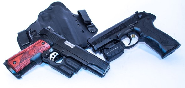 Two of the pistol choice contenders: Springfield Armory TRP 1911 (left) and Beretta PX4 Storm (right)
