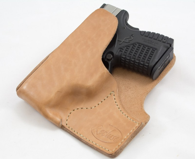 A pocket holster like this Recluse Holsters model offers both good concealment and reasonably good access from a standing position.