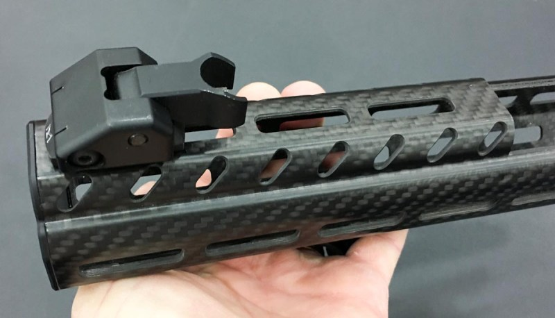 Even the top rail is M-Lock, not Picatinny, so you'll need compatible iron sights.
