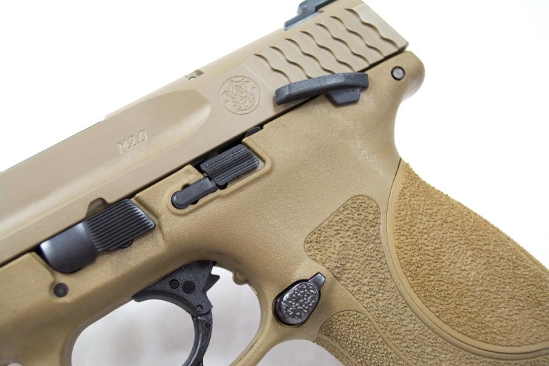 The manual safety locks the trigger, but still allows slide operation.