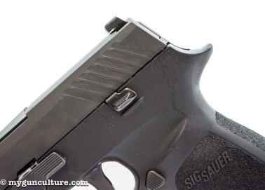 The standard Sig P320 has no manual safety lever, just this slide release lever n both sides of the frame.