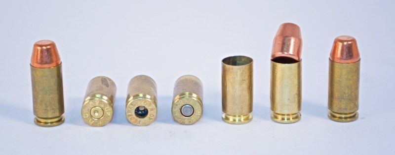 The circle of life: Loaded cartridge, spent brass, primer has been removed, new primer installed, ready for powder, seating a new bullet, and completed cartridge.