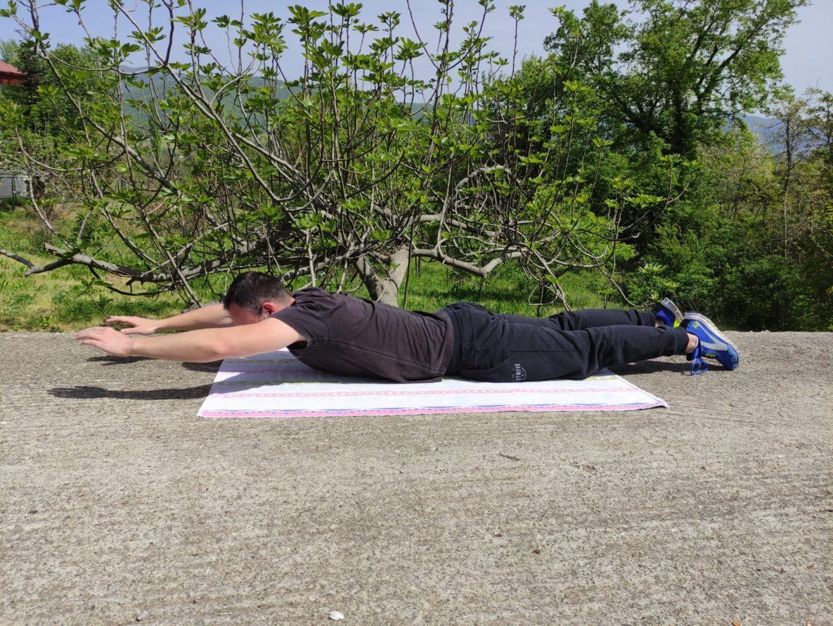 Half superman exercise position