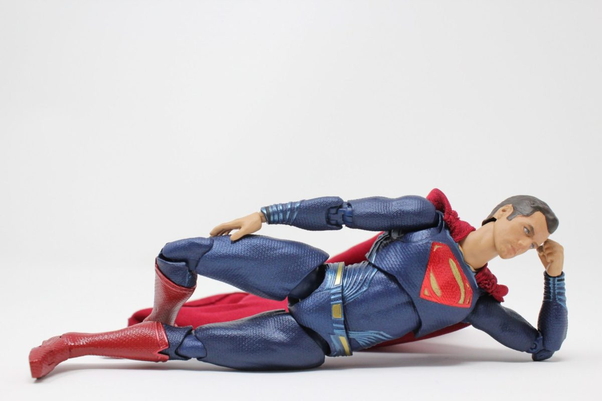 superman toy laying in mermaid sideway position