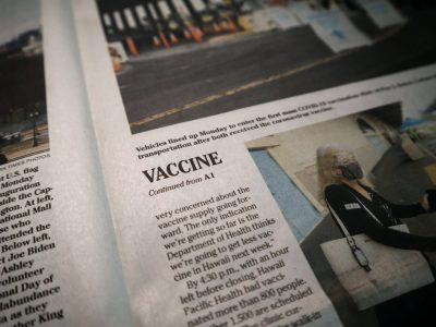 a newspaper with the word vaccine