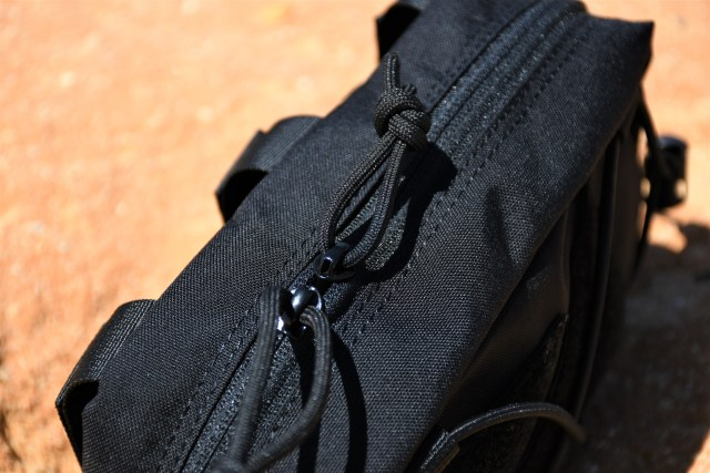 The zips have a loop of paracord that makes using them with gloves simple