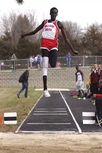 Duoth Deng Leaps high into jump pit.