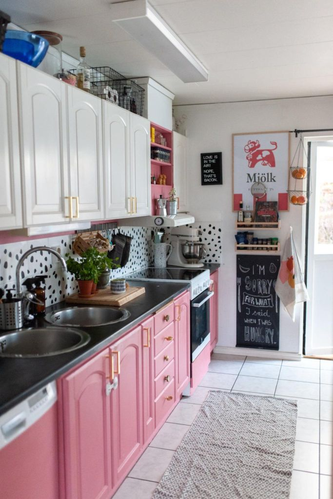 kitchen with posters on the wall