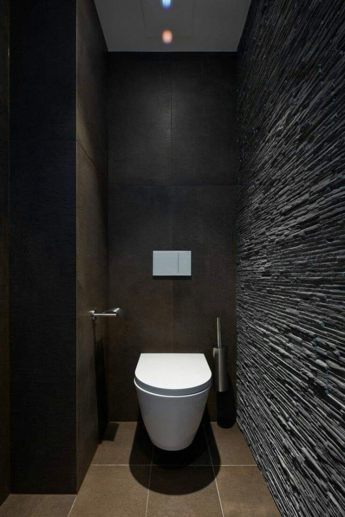 Dark bathroom design in penthouse