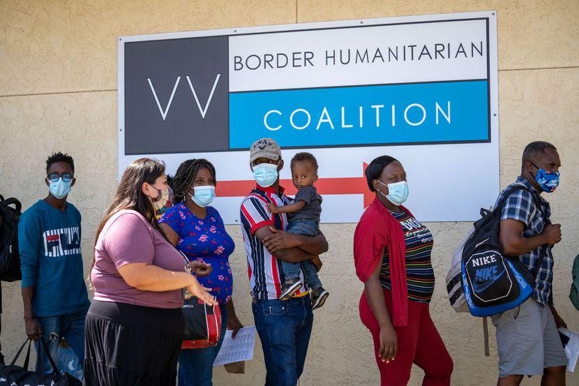 Migrants are greeted Lupita De La Paz at the Del Rio day