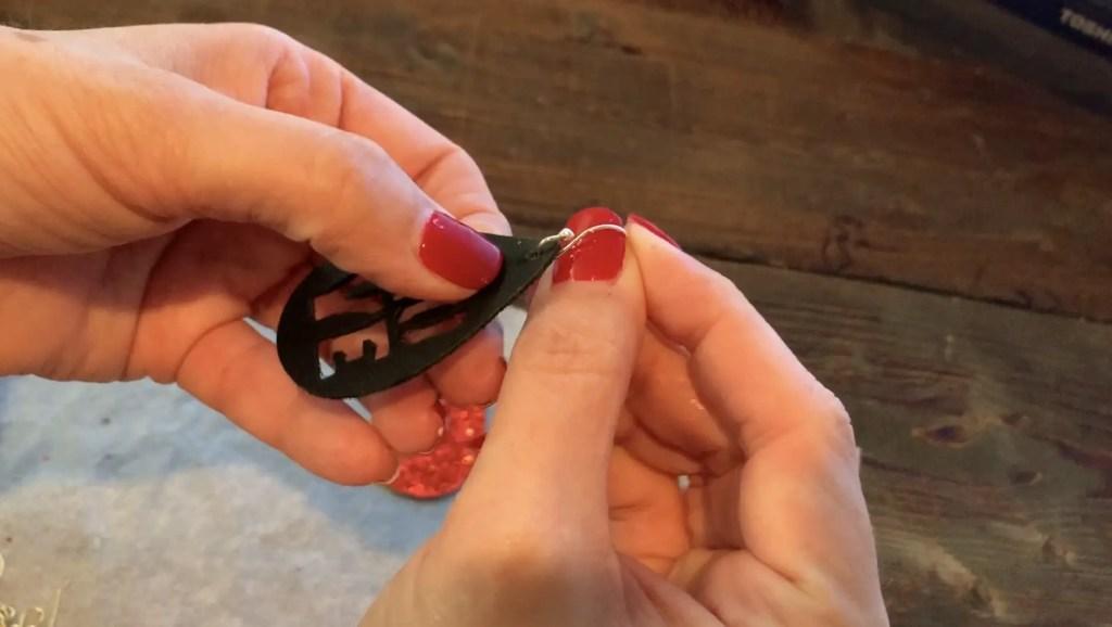 Putting Love earrings diy onto the hooks for Valentine's Day earrings