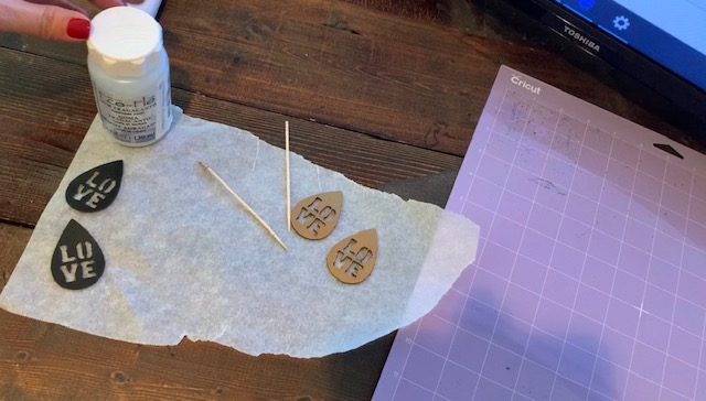 smooth edges of leather earrings to control flyaways