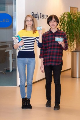 2 students holding their ISIC