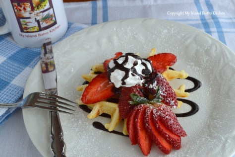 Belgian Waffle with Fresh Strawberries, Whipped Cream, and Chocolate Sauce