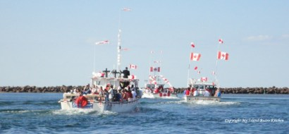 Fishing Boats on Canada Day Parade out of North Rustico Harbour, PEI