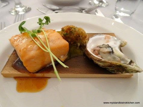 Second Course: Cedar Planked Maple Cured Salmon, Rock Crab Rissole, Mustard Pickle, and Roasted Oyster