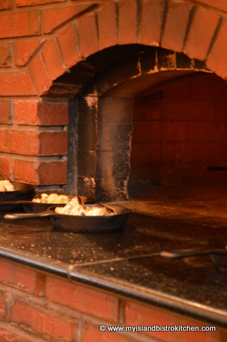 Roasted Cauliflower Emerging from the Brick Oven