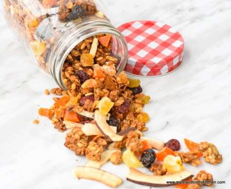 Mason jar with colorful granola spilling out