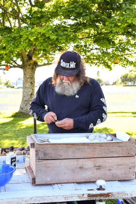 Aquaculturalist, George Dowdle, Shucking Oysters at The Table Culinary Studio, New London, PEI