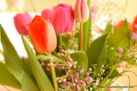 Bouquet of bright pink and orange tulips